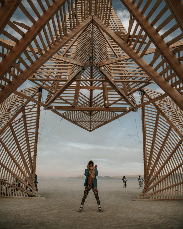 pexels.man-standing-below-a-wooden-structure-2976370